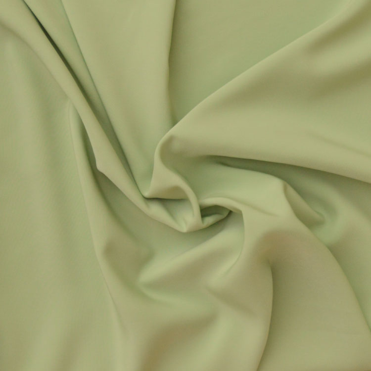 Peachskin luxury crepe fabric // Pale Apple / Pistachio Green// Holm Sown