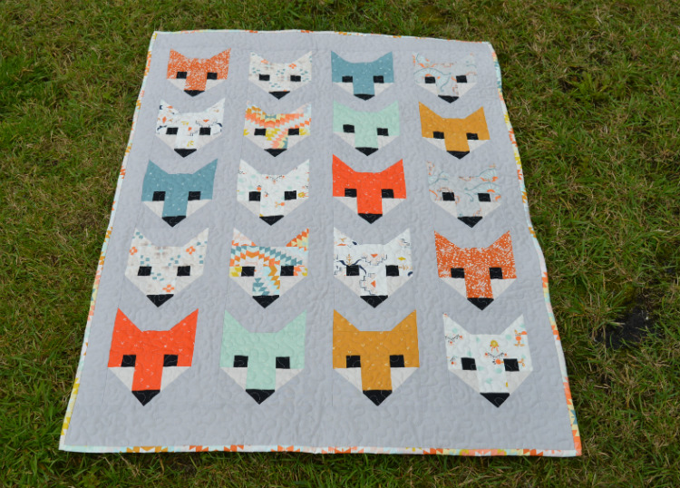 Fancy Fox Quilt - baby size with 20 foxy faces in Wanderer fabric. Sewn by Holm Sown.