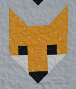 Fancy Fox Quilt - fox face detail. Sewn by Holm Sown.