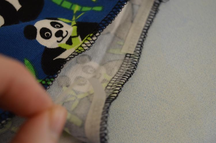 Eclipse Hoodie - applying seam tape to hem // Holm Sown