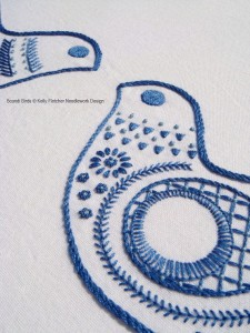 Blue and white embroidered birds