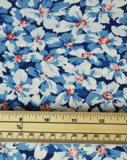 Delia Floral Polyester Crepe Dressmaking fabric - blue | Holm Sown