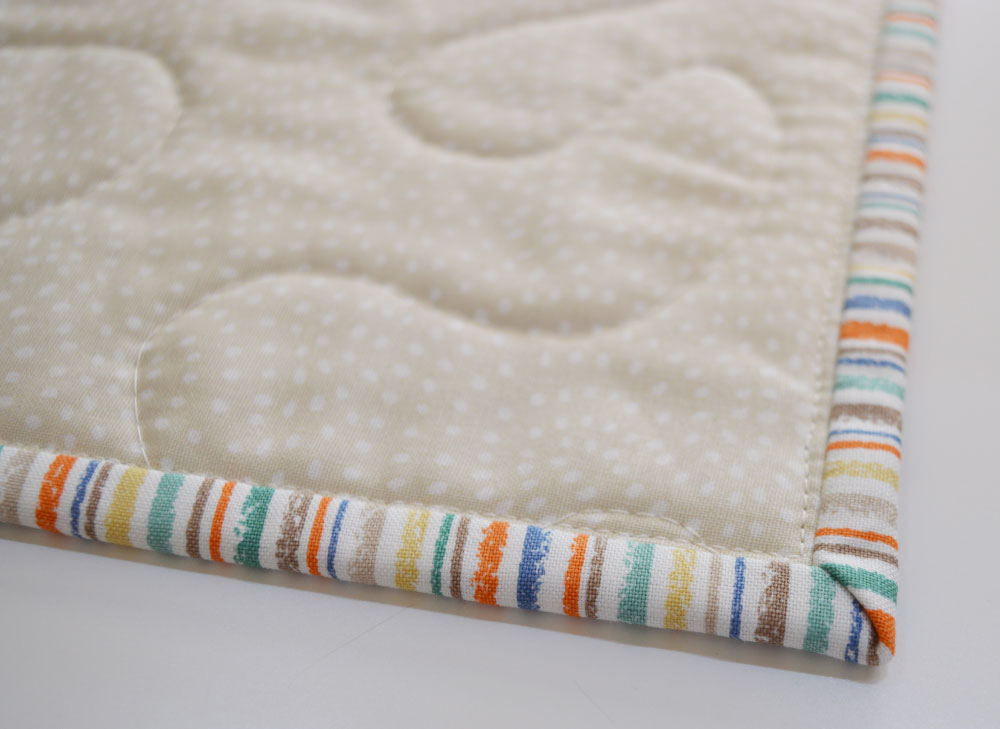 Holm Sown: A Speedy Baby Jungle Quilt - machine sewn quilt binding (wrong-side)