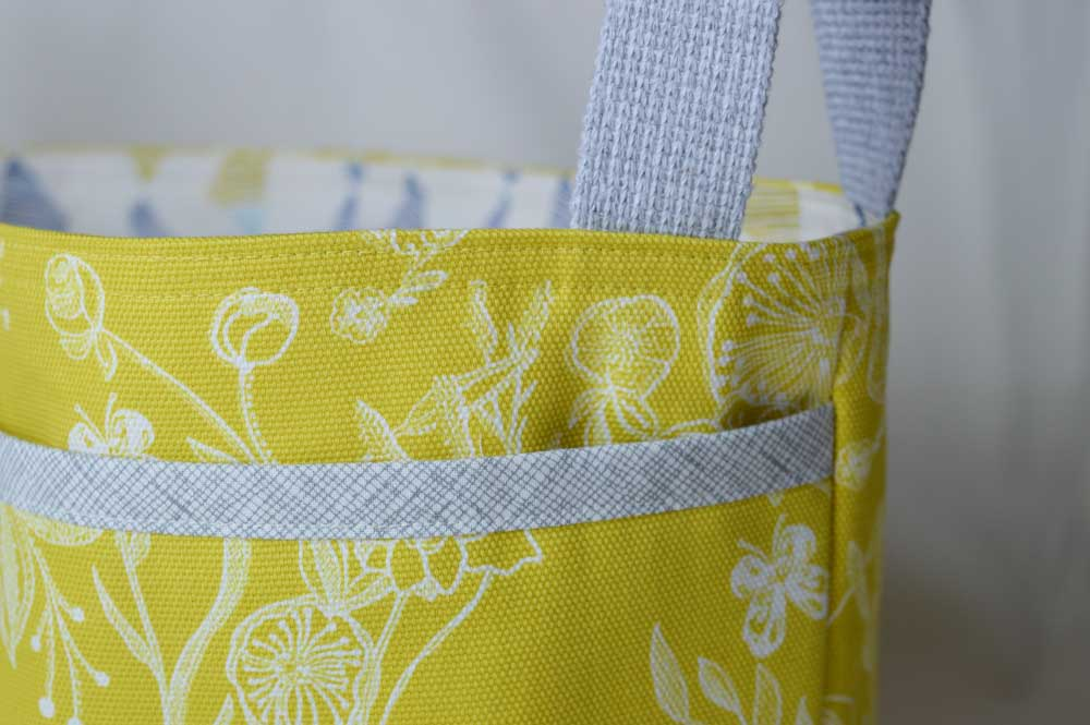 Noodle-head Divided Basket - Millie Fleur Line Drawings Canvas | front pocket detail | Holm Sown