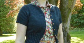 Holm Sown: Peggy Sue Knitted Cropped Cardigan in Malabrigo Arroyo Prussian Blue // front