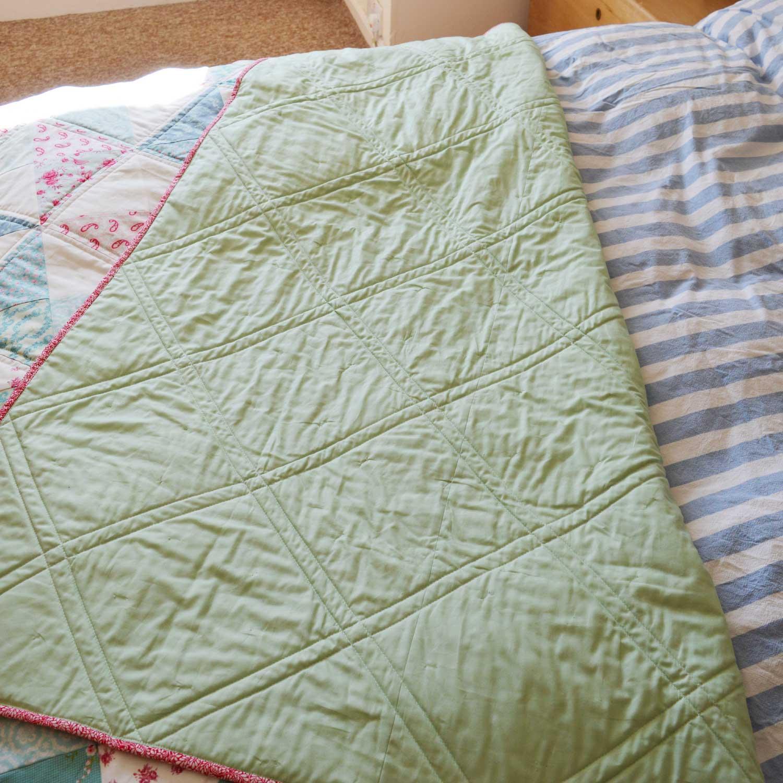 Holm Sown: Tilda Pinwheel Quilt // straight line quilting detail