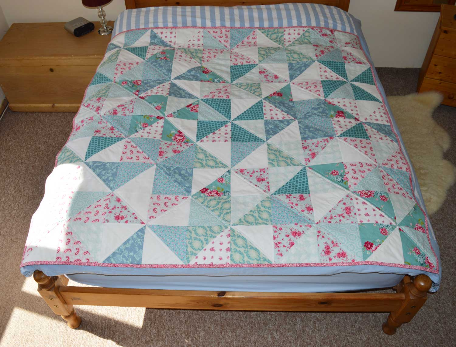 Holm Sown: Tilda Pinwheel Quilt // on double bed