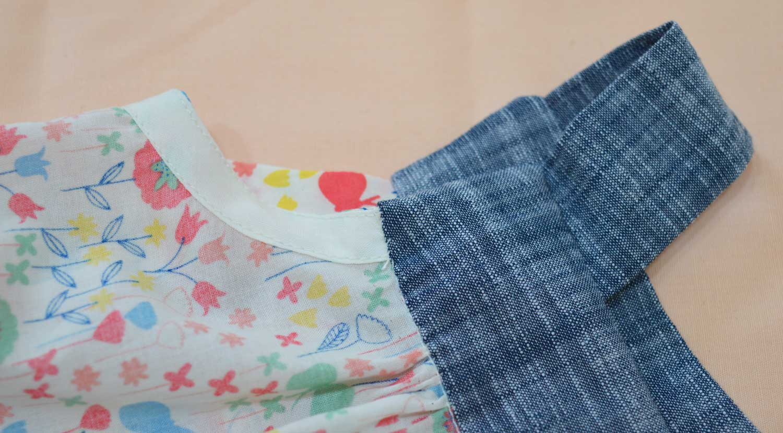 Holm Sown: Kwik Sew K3776 Baby Romper in London Calling Cotton Lawn - Armhole bias binding detail