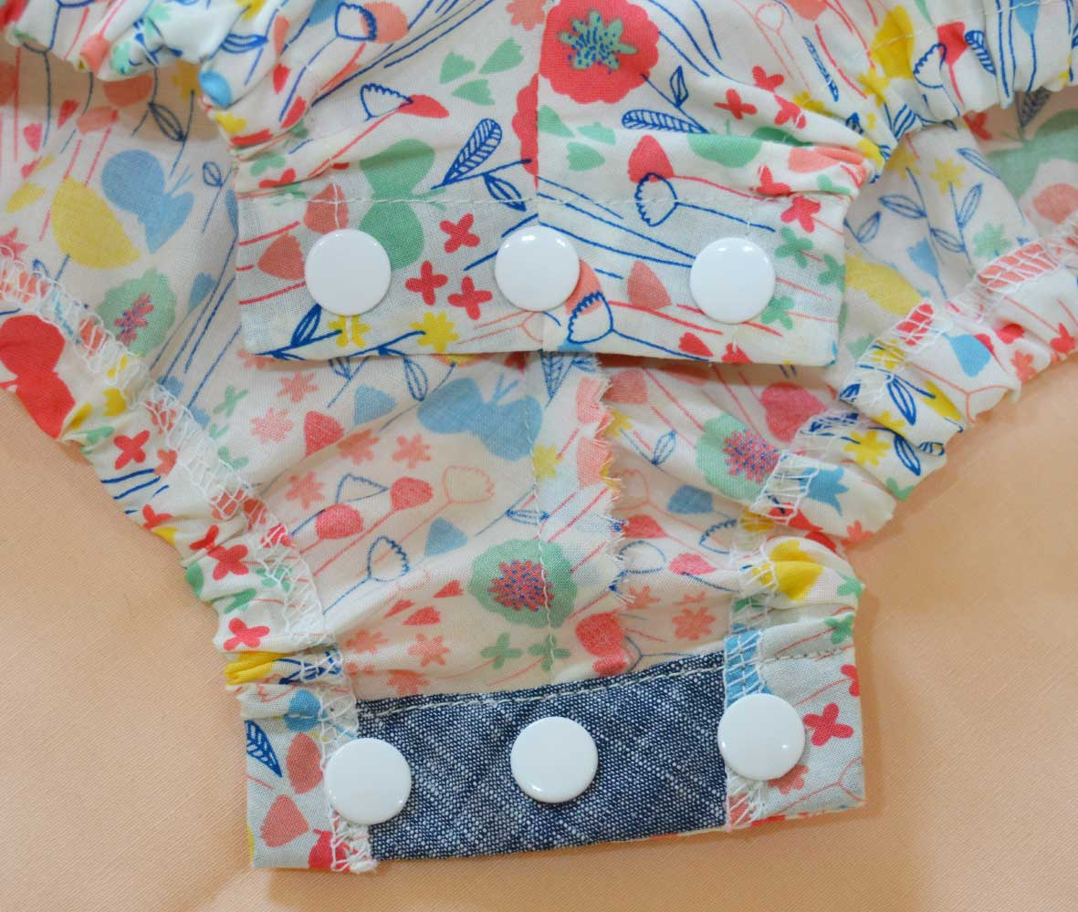 Holm Sown: Kwik Sew K3776 Baby Romper in London Calling Cotton Lawn - crotch popper facing detail