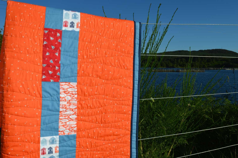 Holm Sown: Whatever Floats Your Boat Porthole Quilt // reverse applique // back detail