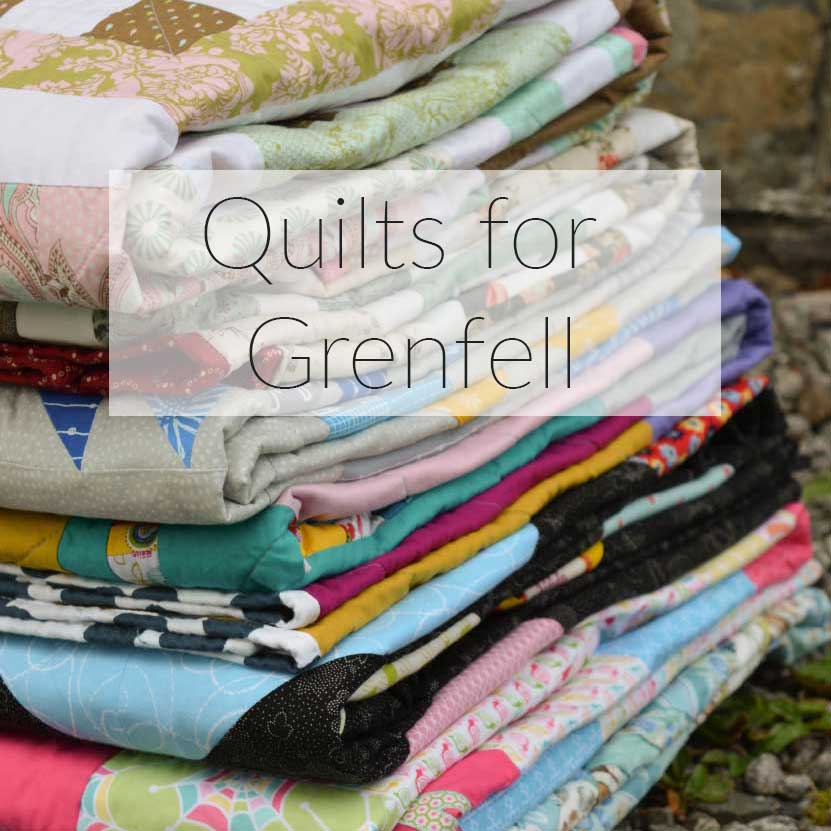 Quilts for Grenfell - Dumfries & Galloway Modern Quilt Guild (DGMQG) // Stack of quilts
